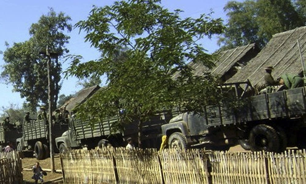 Myanmar trucks and soldiers