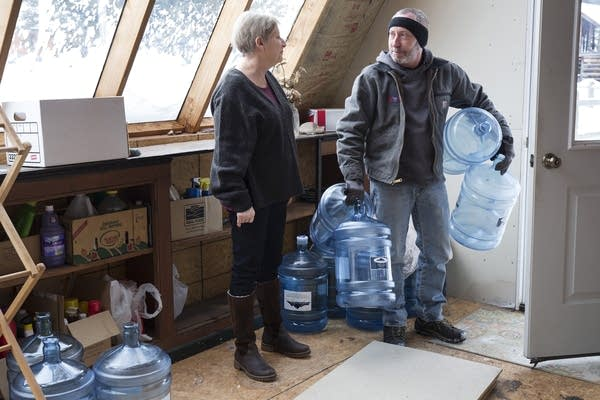 Catherine Maynard receives a bottled water delivery.