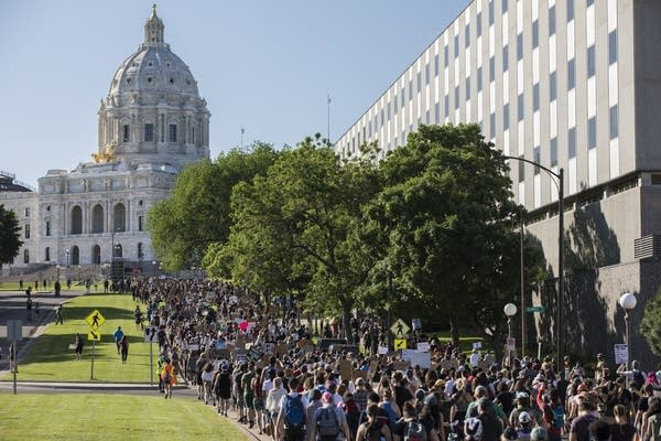 Protesters march toward the Minnesota State Capitol building.