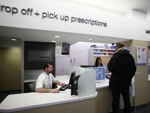 A pharmacist at the counter.