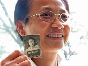 Sova Niev holds her identification photo.