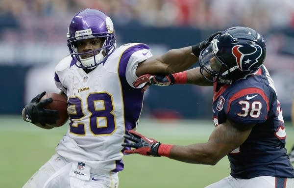 Adrian Peterson of the Minnesota Vikings runs upfield against Daniel Manning #38 of the Houston Texans at Reliant Stadium on December 23, 2012 in Houston, Texas.  (Photo by Scott Halleran/Getty Images)
