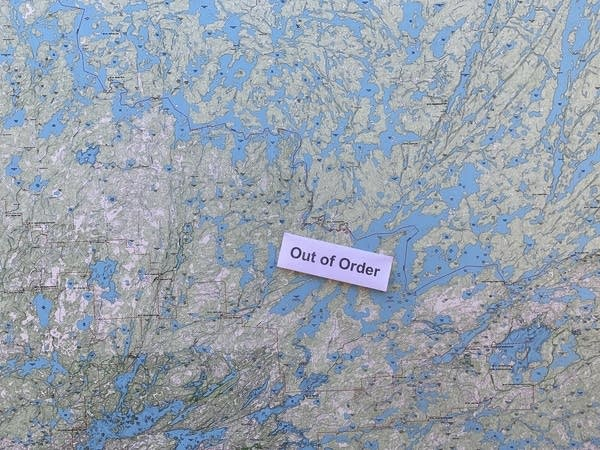 """A map with a note that reads """"Out of Order"""""""