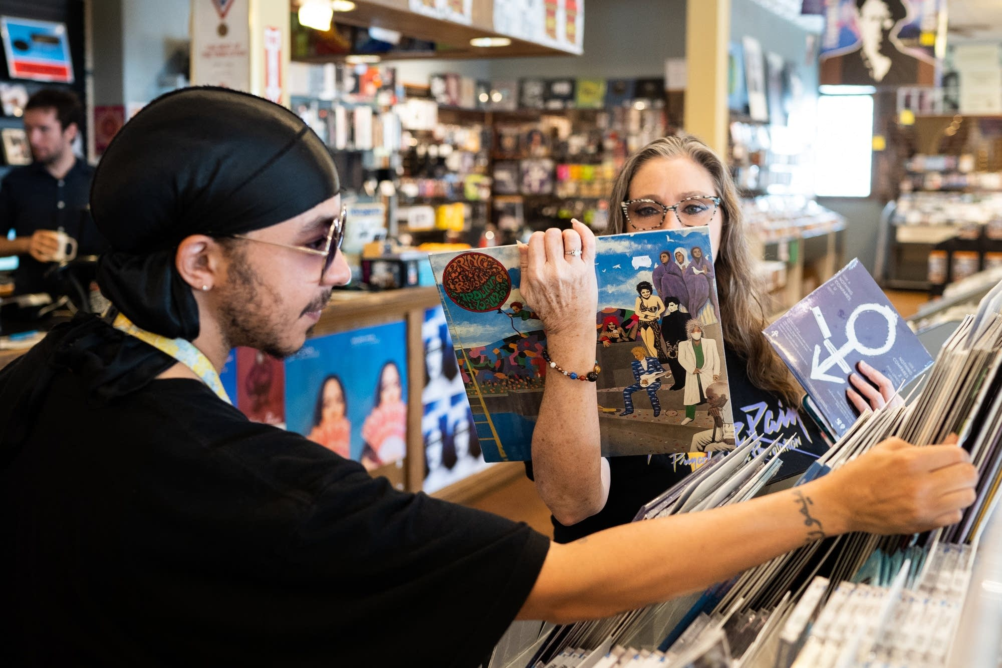 Austin Douglas and Stephanie Jeffrey browse a special Prince section.