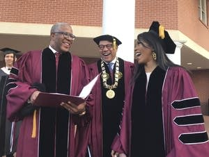 Robert F. Smith (left) laughs with David Thomas and actress Angela Bassett