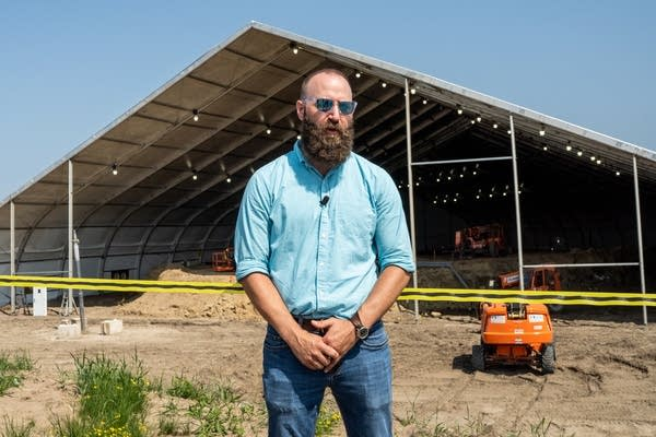 Cliff Shierk stands in front of a large tent-like structure.