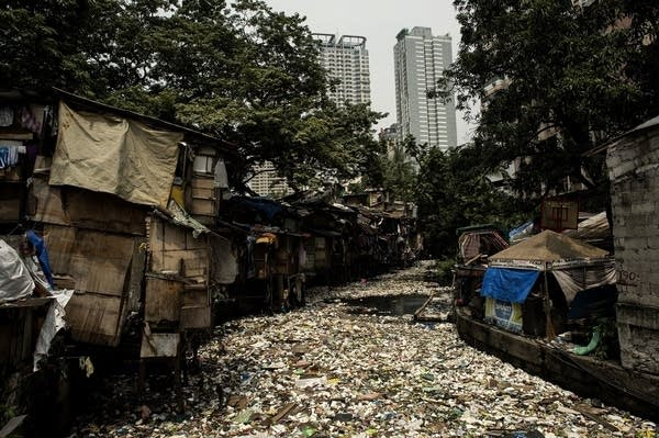 Garbage floats on a creek in Manila