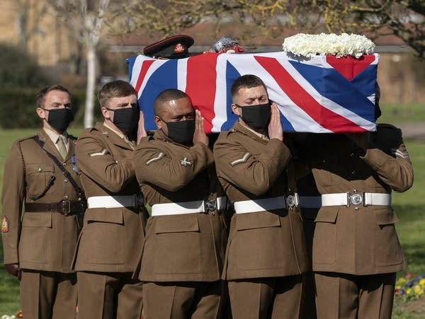 A coffin is carried at a funeral