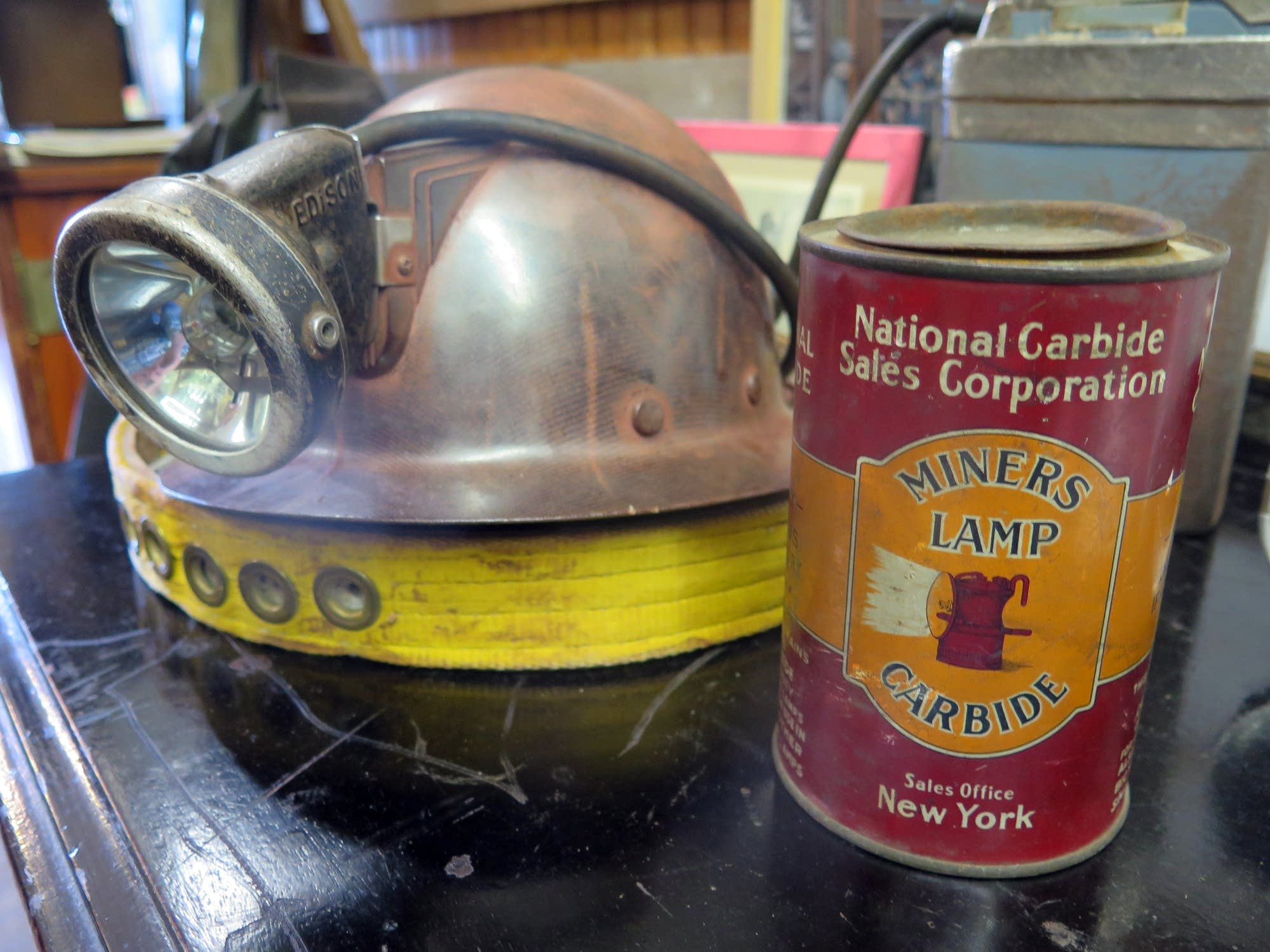 An old miner's helmet and a can of carbide.