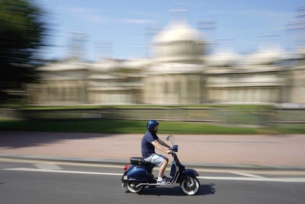 A scooter driving through Brighton in the summer of 2019