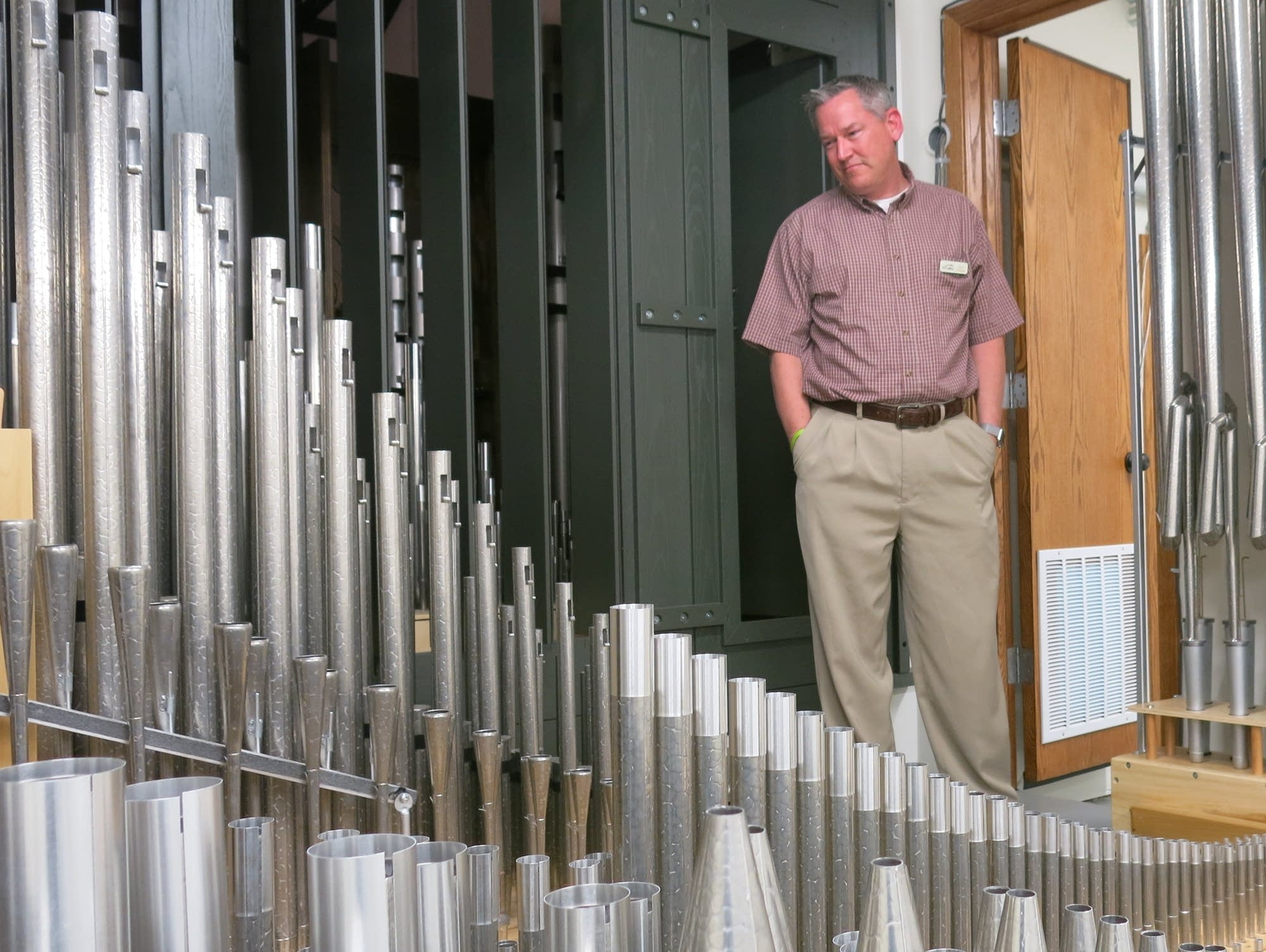 Pastor Corey Fuhrman walks through the custom pipe organ.