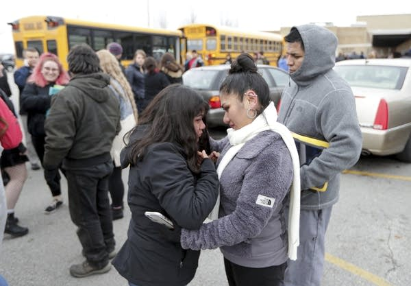 A student talks to her mother after a shooting incident at her school.