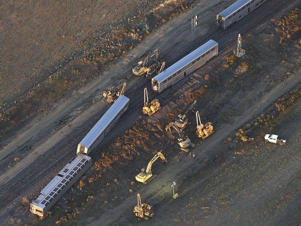 Aerial view of a derailed train