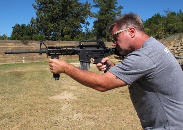 The stock uses recoil of the rifle to let the finger 'bump' the trigger.