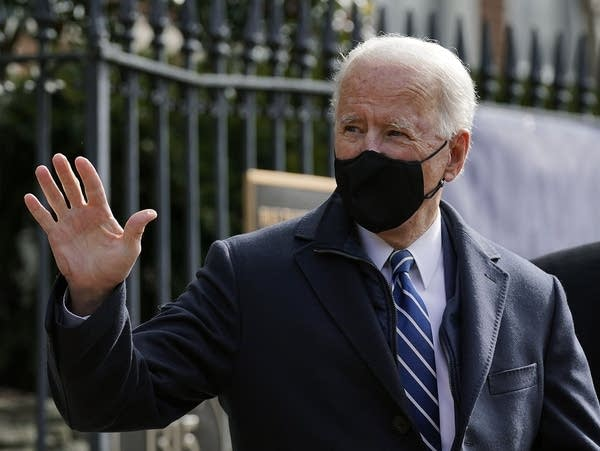 President Joe Biden waves as he leaves a church