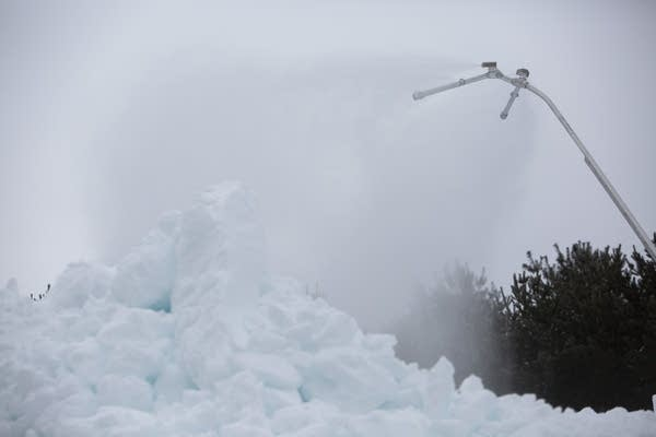 A snow gun creates artificial snow used on the trails.