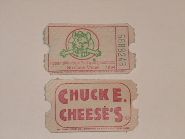 Two game tickets from Chuck E Cheese showing a mouse and the logo