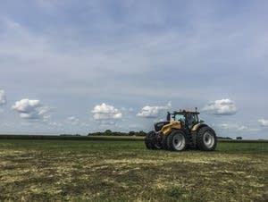 Elizabeth Dunbar drives a tractor at Farmfest 2017.