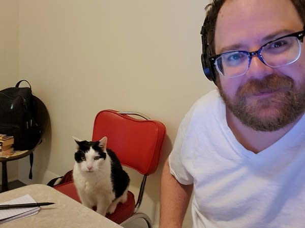 Andrew and his old, noisy cat Theo in the studio