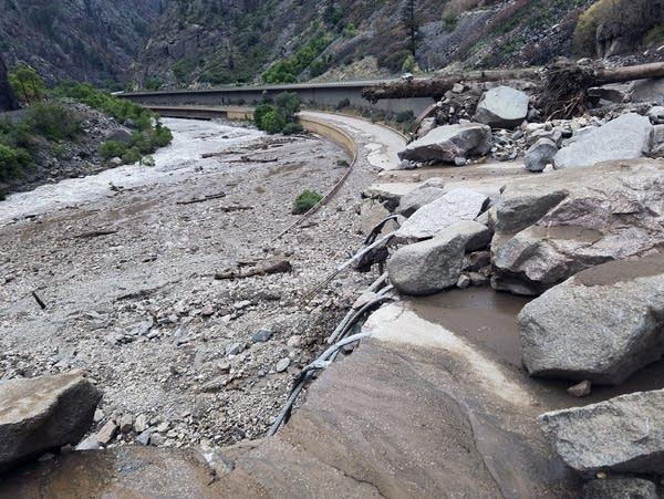 Flood debris covers a highway