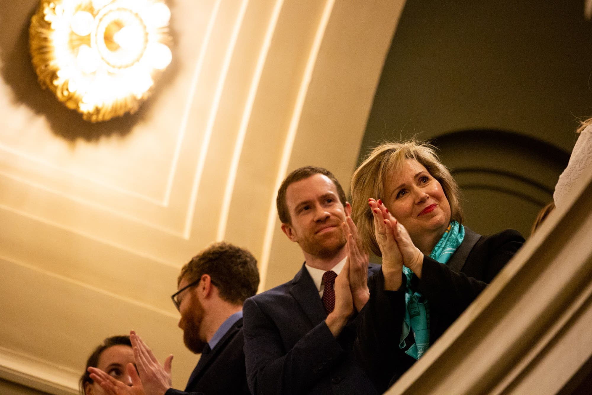 First Lady Gwen Walz claps during Gov. Tim Walz's State of the State.