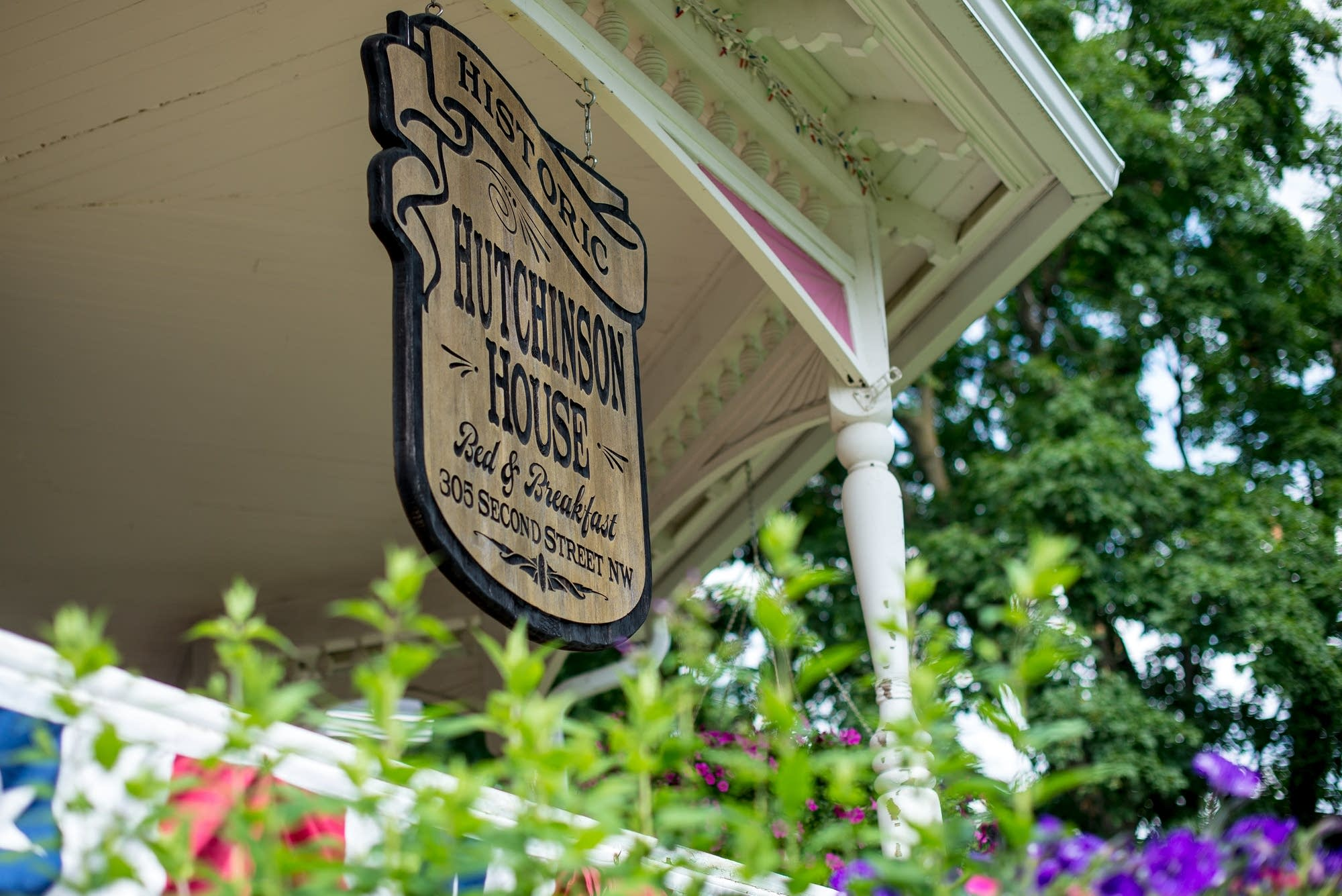 The Historic Hutchinson House Bed & Breakfast sign hangs on the porch.