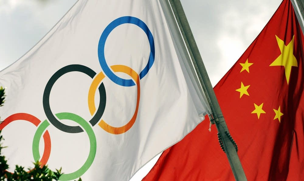 An Olympic and Chinese flags