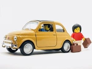 MIniature car and figurines.