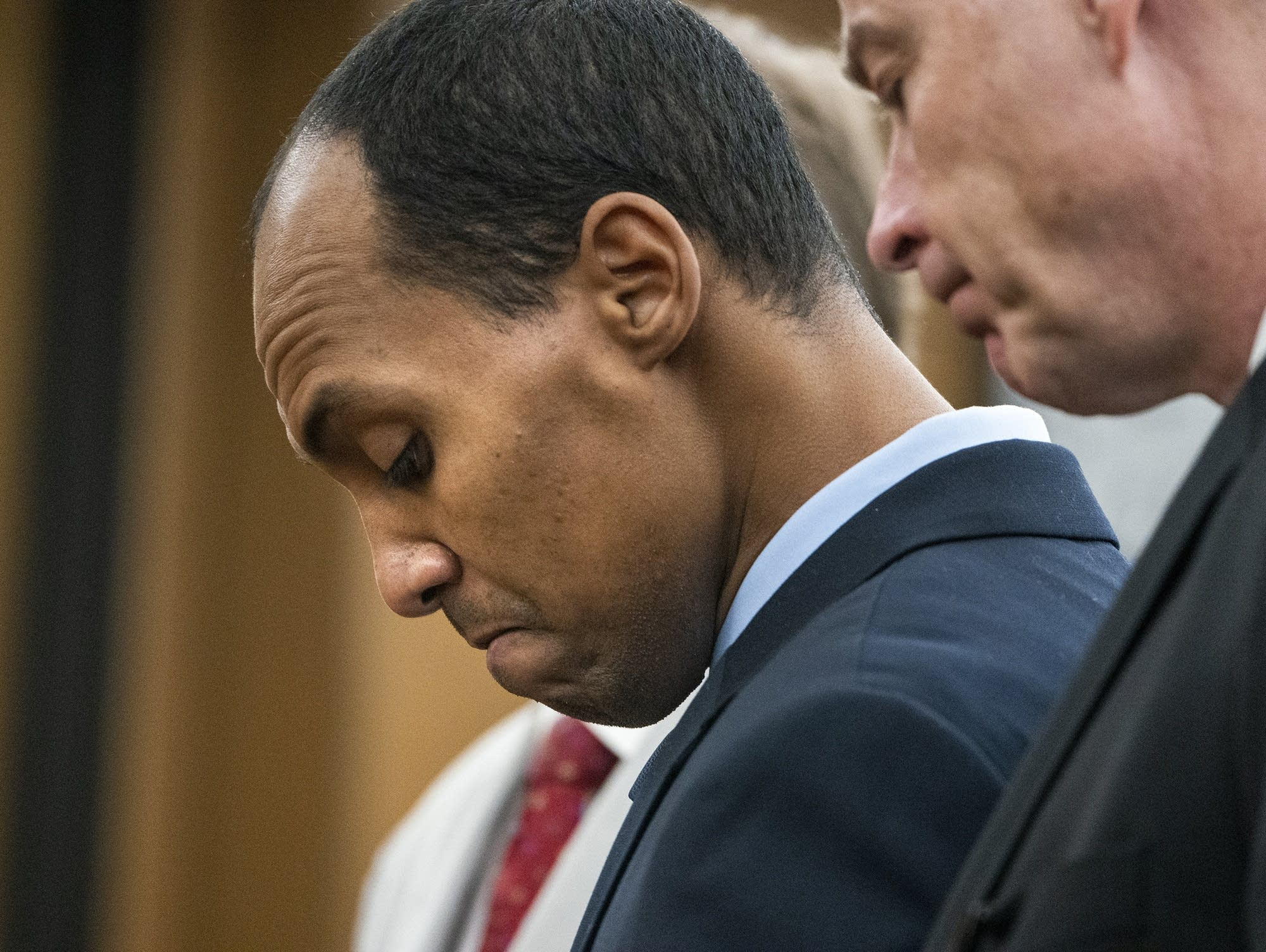 Mohamed Noor reads a statement at Hennepin County District Court