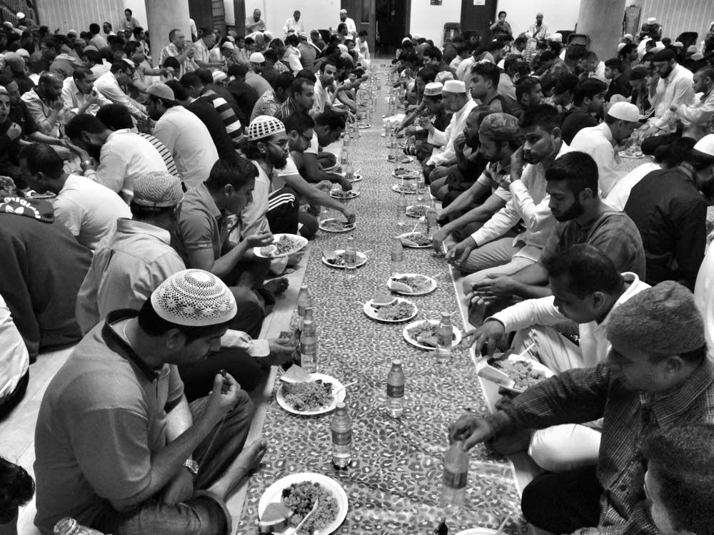 Muslim men break fast with Iftar
