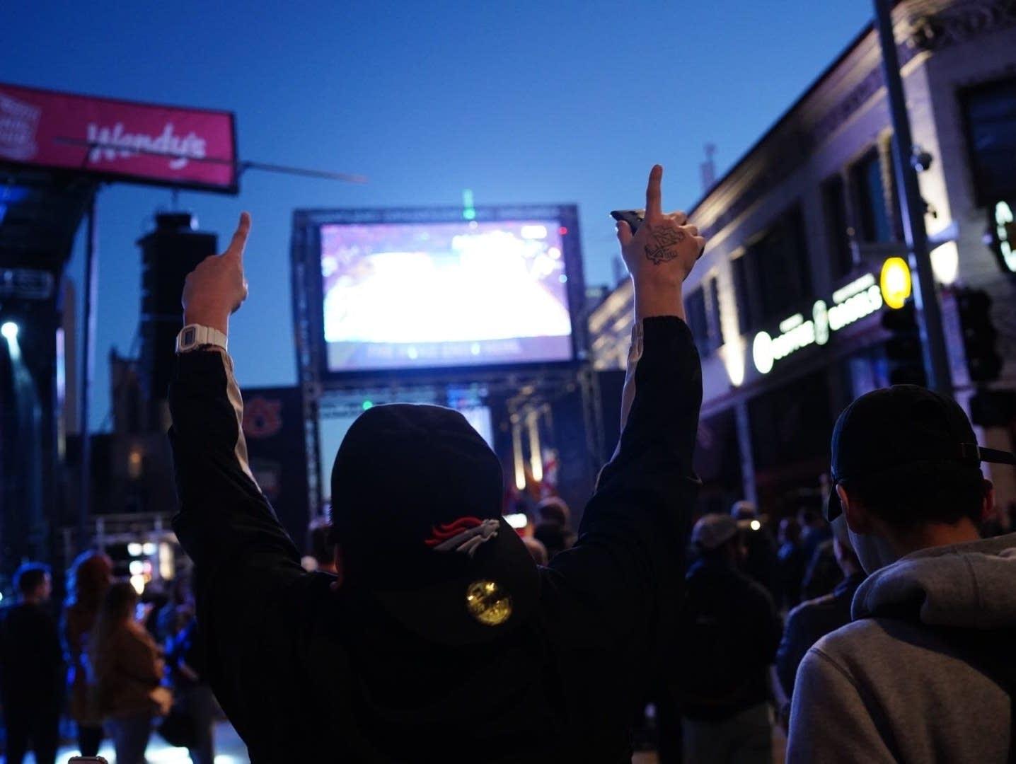 A Texas Tech fan throws his hands in the air.