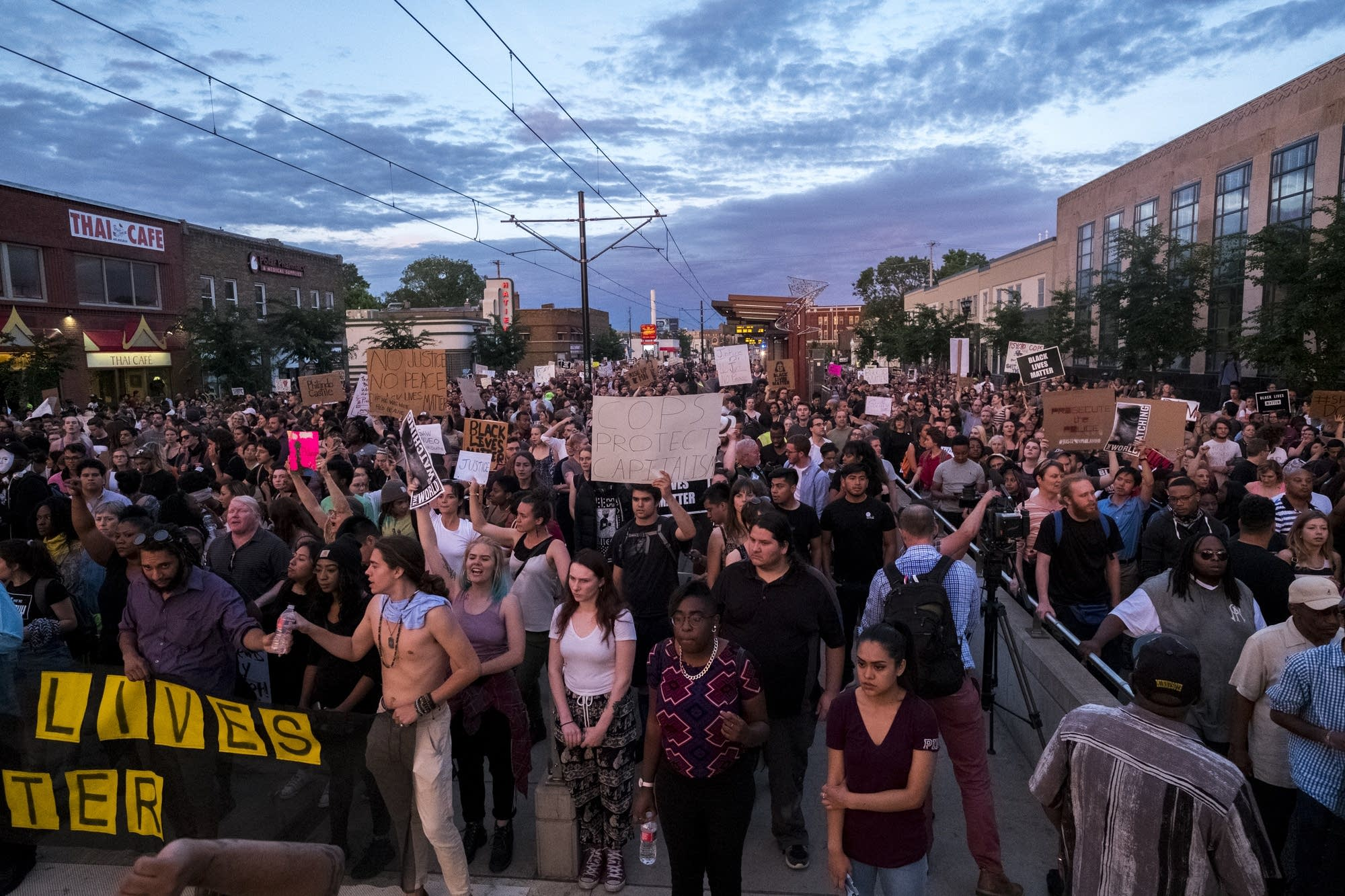 Over 1,000 protesters stop on University.
