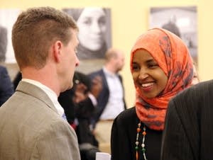 Lobbyist Shep Harris talks with Rep. Ilhan Omar.