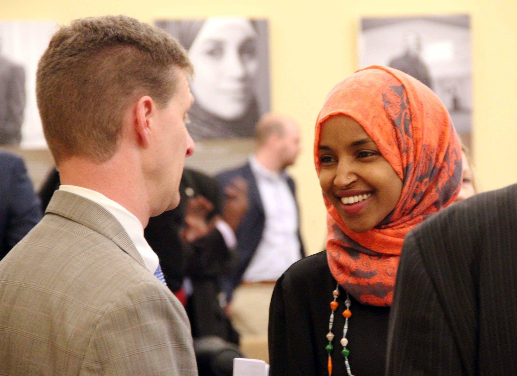 Lobbyist Shep Harris talks with Rep. Ilhan Omar.