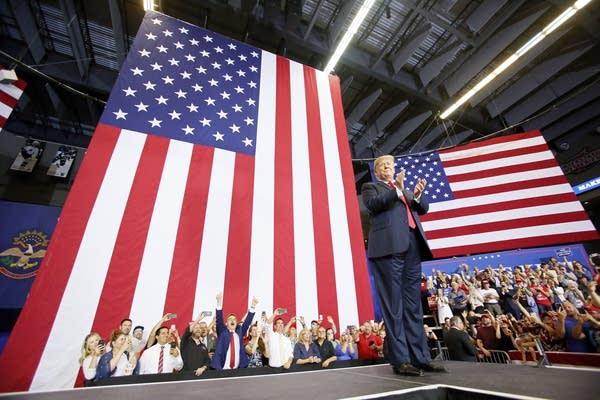 President Donald Trump enters Scheels Arena in Fargo on Wednesday.