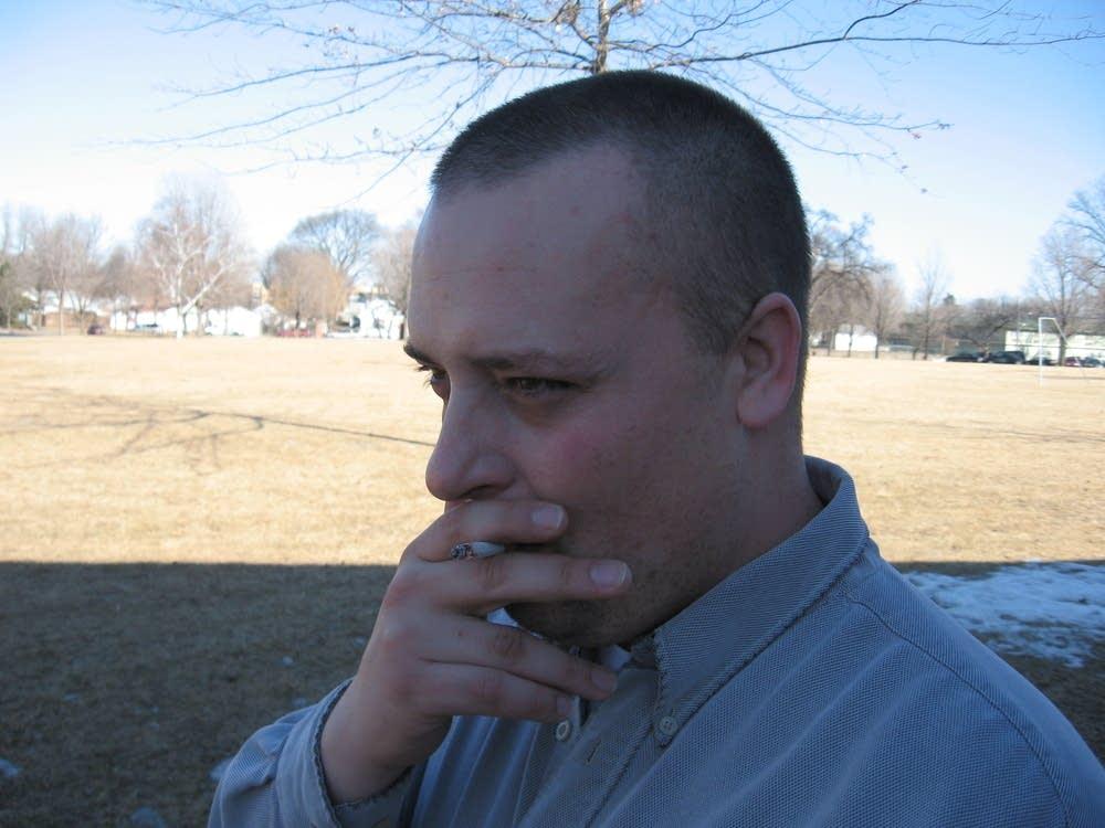 Andrew smokes a cigarette
