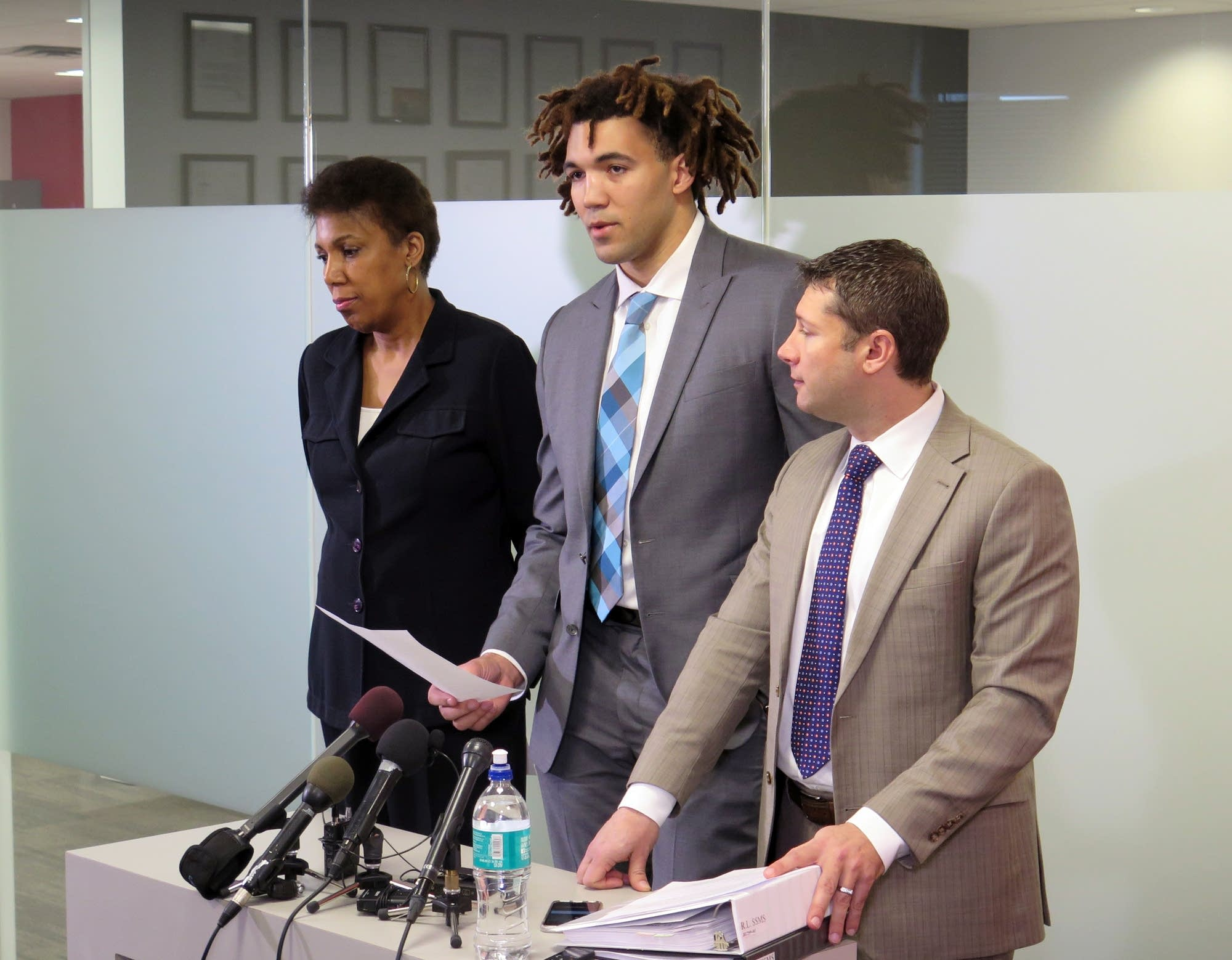 Reggie Lynch reads a statement at his attorney's office.