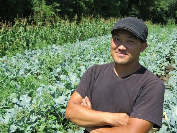 A famer in front of his crops.