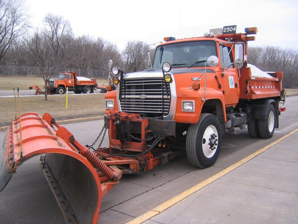 Snow plows wait for storm