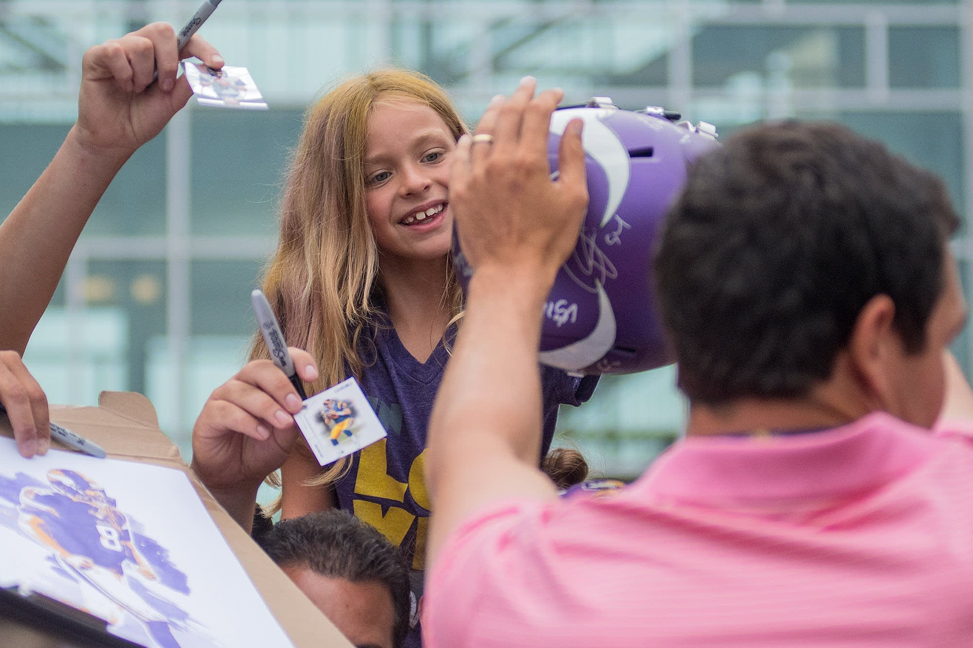 Ellie Hatlevig gets a signed helmet back from Sam Bradford.