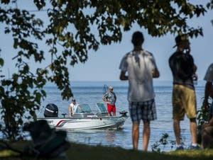 Anglers on Lake Winnibigoshish return to shore.