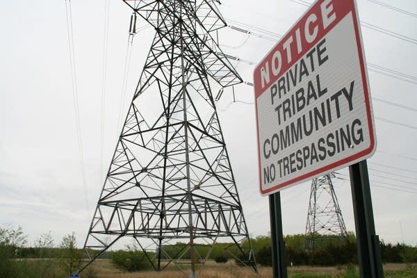 The tribal community sits very close to the plant