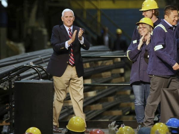 Vice President Mike Pence waves to steel workers in St. Paul.