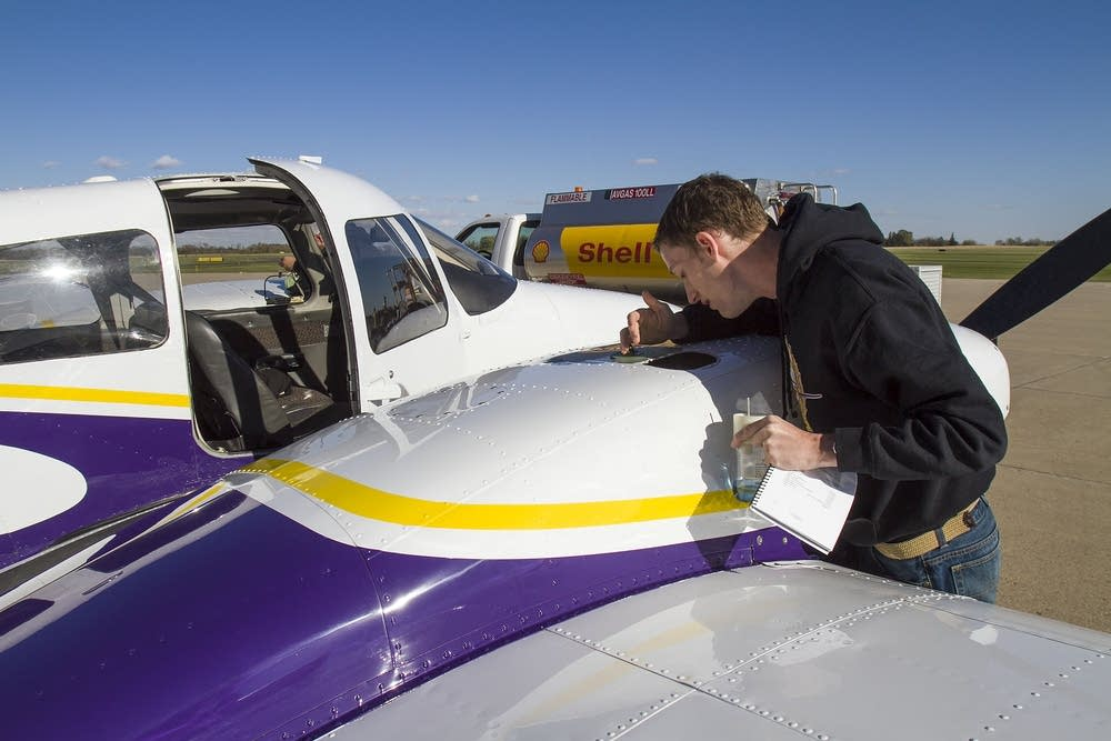 Aviation student Ethan Troe checked oil levels.