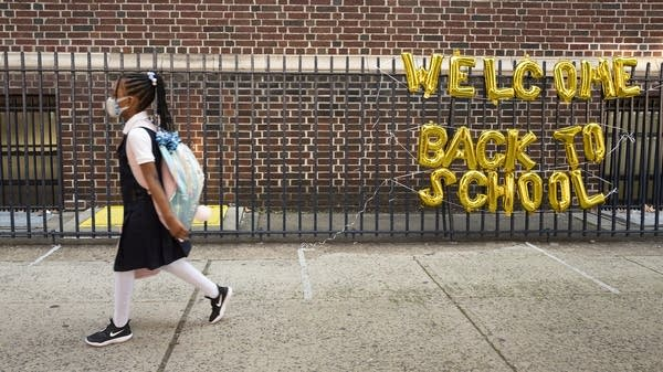 A student arrives for the first day of class