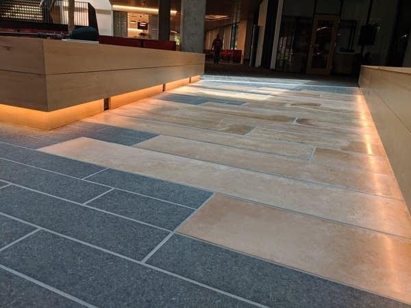 Orange stone set into the floor of the new lobby at Minnehaha Academy .