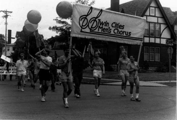 Twin Cities Men's Chorus marches in Minneapolis Gay Pride parade, 1986