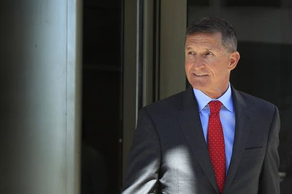 Michael Flynn leaves the federal courthouse in Washington.