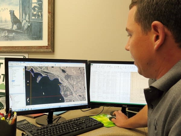Casey Gwost examined aerial photos.