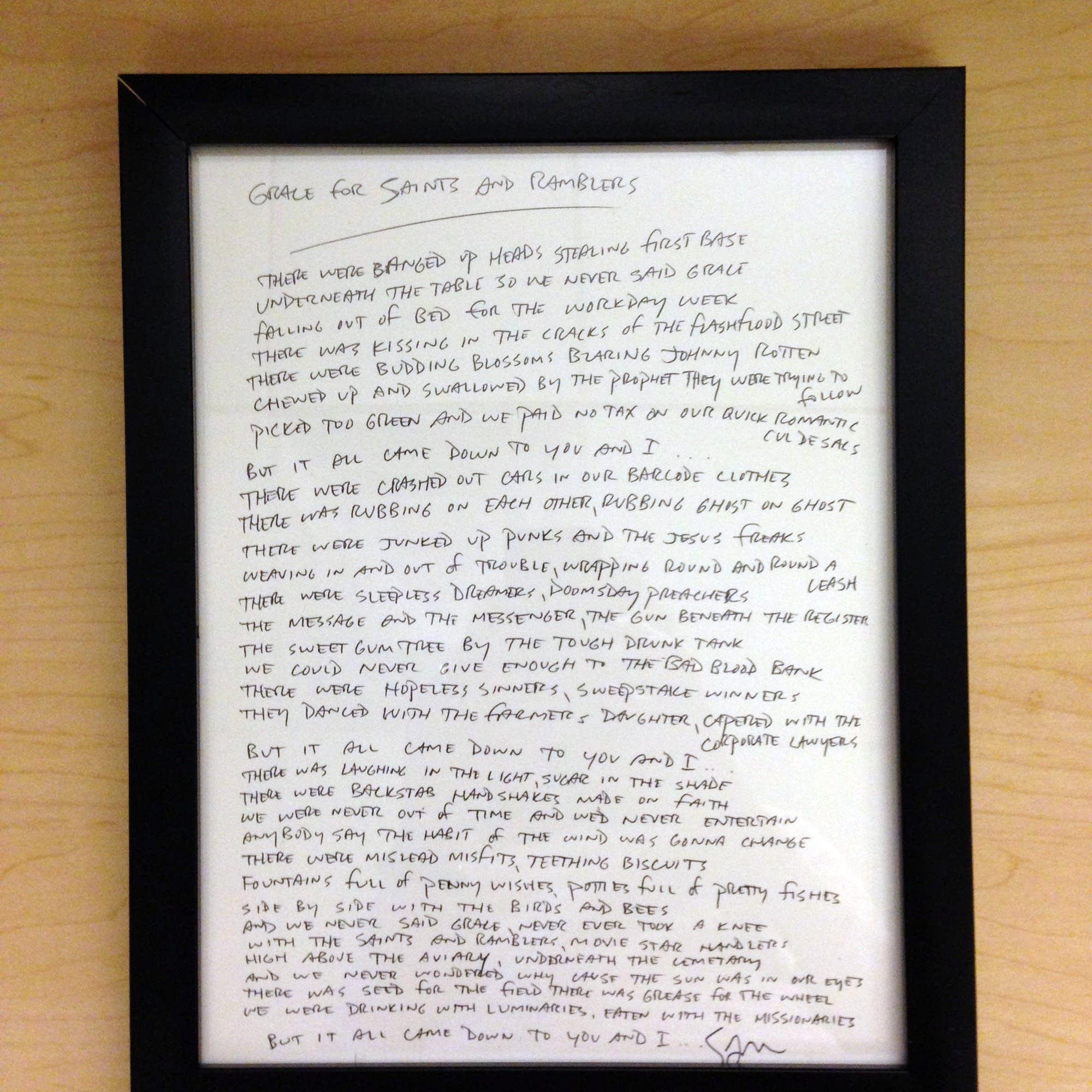 Lyric sheet signed by Sam Beam.